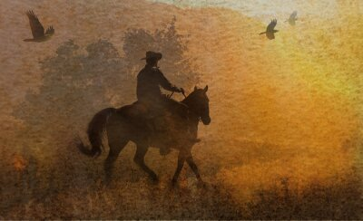 Bild A dramatic design of a cowboy and his horse riding in a meadow into the sunset with crows flying above.  A mixed media piece of artwork in photography and watercolor.