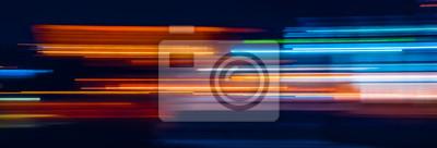 Bild Abstract Rainbow light trails on the dark background