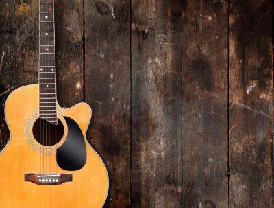Bild Acoustic Guitar on Rustic Background