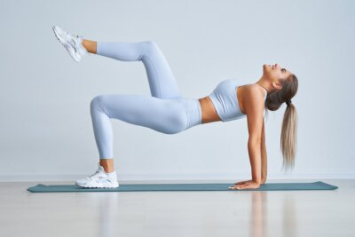 Bild Adult beautiful woman working out over light background