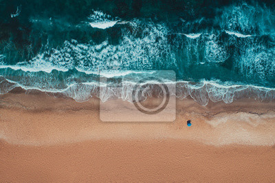 Bild Aerial top view from drone of sandy beach with turquoise sea waves with copy space for text