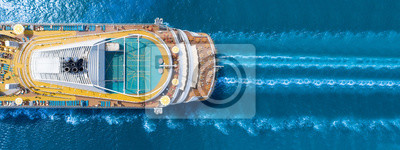 Bild Aerial view of beautiful white cruise ship above luxury cruise close up at stern of cruise sail with contrail in the ocean sea  concept tourism travel on holiday take a vacation time on summer.