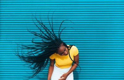 Bild African american woman waving her dreadlocks