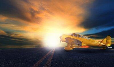 Bild Alte gelbe Propellerflugzeug auf Flughafen-Start-und Landebahn mit Sonnenuntergang Himmel bac