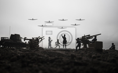 Bild An anti-aircraft cannon and Military silhouettes fighting scene on war fog sky background. Allied air forces attacking on German positions. Artwork decorated scene.