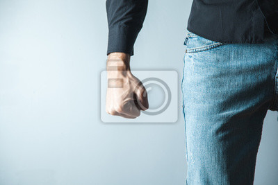 Bild angry man fist on gray wall background