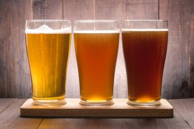 Bild Assortment of beer glasses on a wooden table