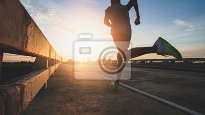 Bild Athlete runner feet running on road, Jogging at outdoors. Man running for exercise.Sports and healthy lifestyle concept.