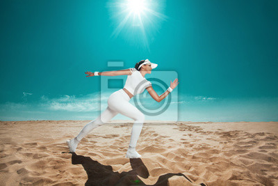 Athlete runner. Sporty and fit woman running on the sky background. The concept of a healthy lifestyle and sport. Girl in white sportswear.
