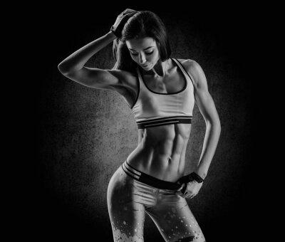 Bild attractive fitness woman, trained female body, lifestyle portrai