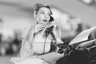 Bild Attractive young woman speaking on  vintage phone