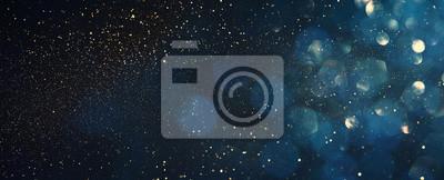 Bild background of abstract glitter lights. blue, gold and black. de focused. banner