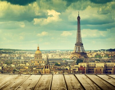 Bild background with wooden deck table and Eiffel tower in Paris