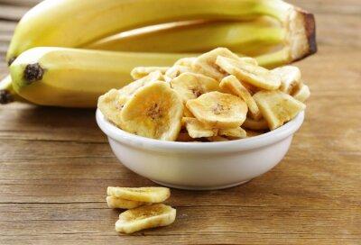 Bild Bananen-Chips, getrocknete Früchte auf einem Holztisch