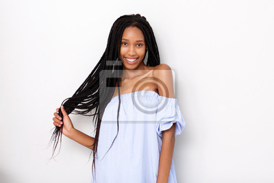 Bild beautiful african american woman with braided hair smiling against white background