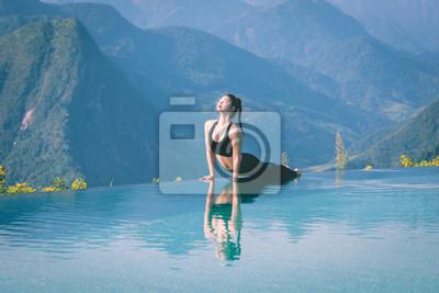 Beautiful Attractive Asian woman practice yoga Cobra pose on the pool above the Mountain peak in the morning in front of beautiful nature views in SAPA vietnam,Feel so comfortable and relax in holiday