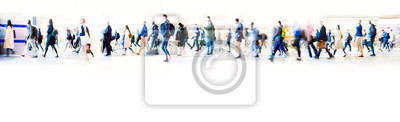 Bild Beautiful motion blur of walking people in train station. Early morning rush hours, busy modern life concept. Ideal for websites and magazines layouts
