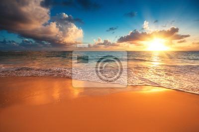Beautiful sunrise over the sea. Tropical beach.