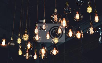 Bild Beautiful vintage luxury light lamp hanging decor glowing in dark. Retro filter effect style.