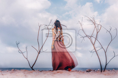 Bild Beautiful young boho style woman outdoors with dry branches. Spiritual concept. Double exposure