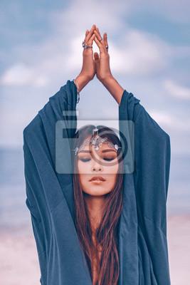 Bild Beautiful young stylish woman portrait outdoors. shaman concept