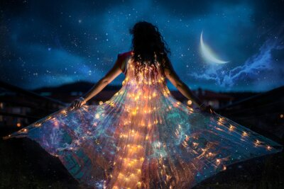 Bild Belly dancer with wings of light under a starry sky