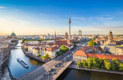 Bild Berlin skyline panorama with TV tower and Spree river at sunset, Germany