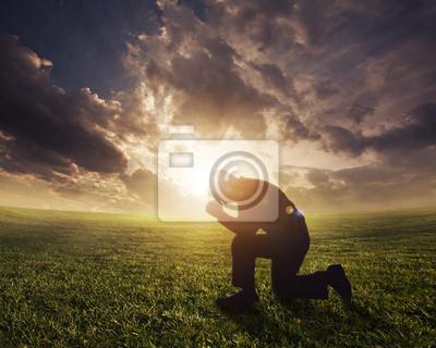 Beten bei Sonnenuntergang