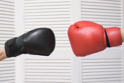 Black and red boxing gloves. Confrontation.White background