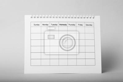 Bild Blank paper calendar on grey background. Planning concept
