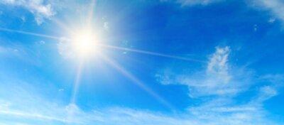 Bild Blue sky. Bright midday sun illuminates the space. Wide photo .