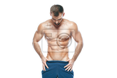 Bild bodybuilder posing. Beautiful sporty guy male power. Fitness muscled in blue shorts. on isolated white background. Man with muscular torso. Strong Athletic Man Fitness Model Torso showing six pack abs
