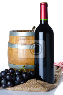 Bild Bottle of wine with black grapes and a cask on a burlap bag