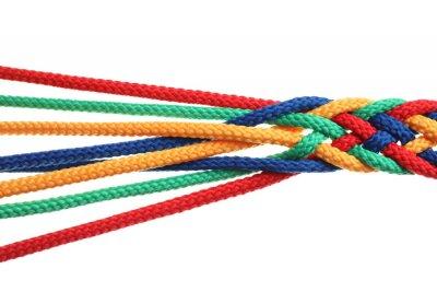 Bild Braided colorful ropes on white background. Unity concept
