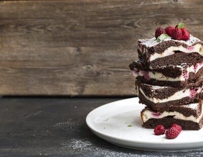 Bild Brownies-cheesecake tower with raspberries on white plate