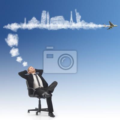 Business-Mann träumt seinen Urlaub