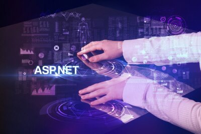 Businessman touching huge display with ASP.NET inscription, modern technology concept