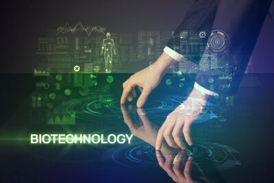 Businessman touching huge display with BIOTECHNOLOGY inscription, modern technology concept