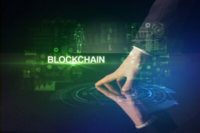 Businessman touching huge display with BLOCKCHAIN inscription, modern technology concept
