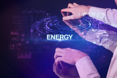 Businessman touching huge display with ENERGY inscription, modern technology concept