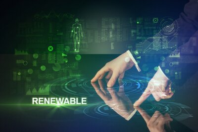 Businessman touching huge display with RENEWABLE inscription, modern technology concept