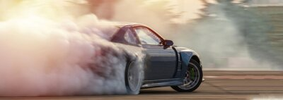 Bild Car drifting, Blurred  image diffusion race drift car with lots of smoke from burning tires on speed track.