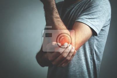 Bild Caucasian man with elbow pain. Pain relief concept