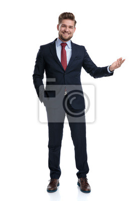 Bild Cheerful businessman presenting with his hand in his pocket