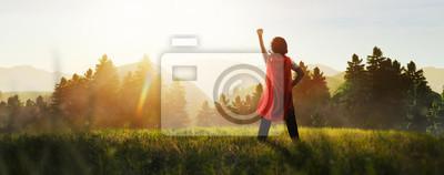 Bild child dreaming of super hero in the mountain