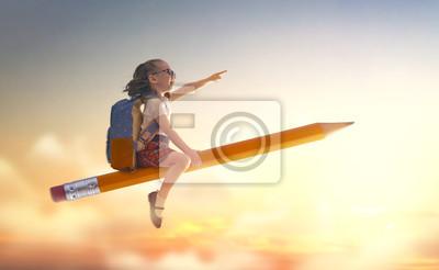 Bild child flying on a pencil