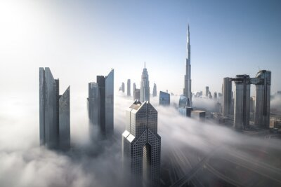 Bild Cityscape of Dubai Downtown skyline on a foggy winter day. Dubai, UAE.