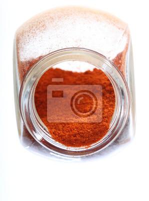 Close up Glas mit Paprika würzen isoliert