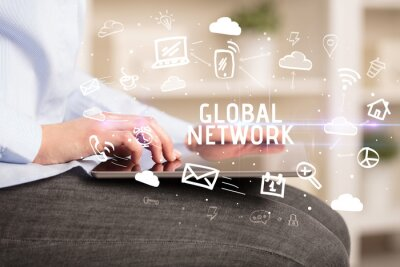 Close-up Of A Person Using Social Networking with GLOBAL NETWORK inscription