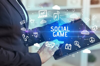 Close-up Of A Person Using Social Networking with SOCIAL GAME inscription
